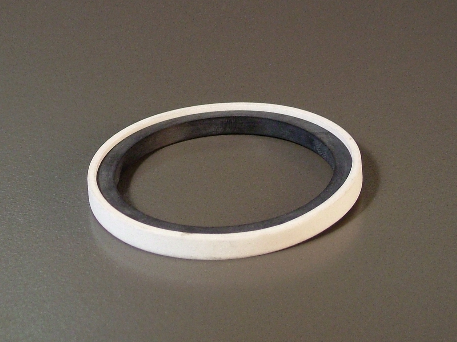 Composite seal rubber energizer with teflon